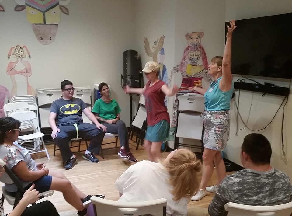 Participants of the Theatre class practicing stage presence.