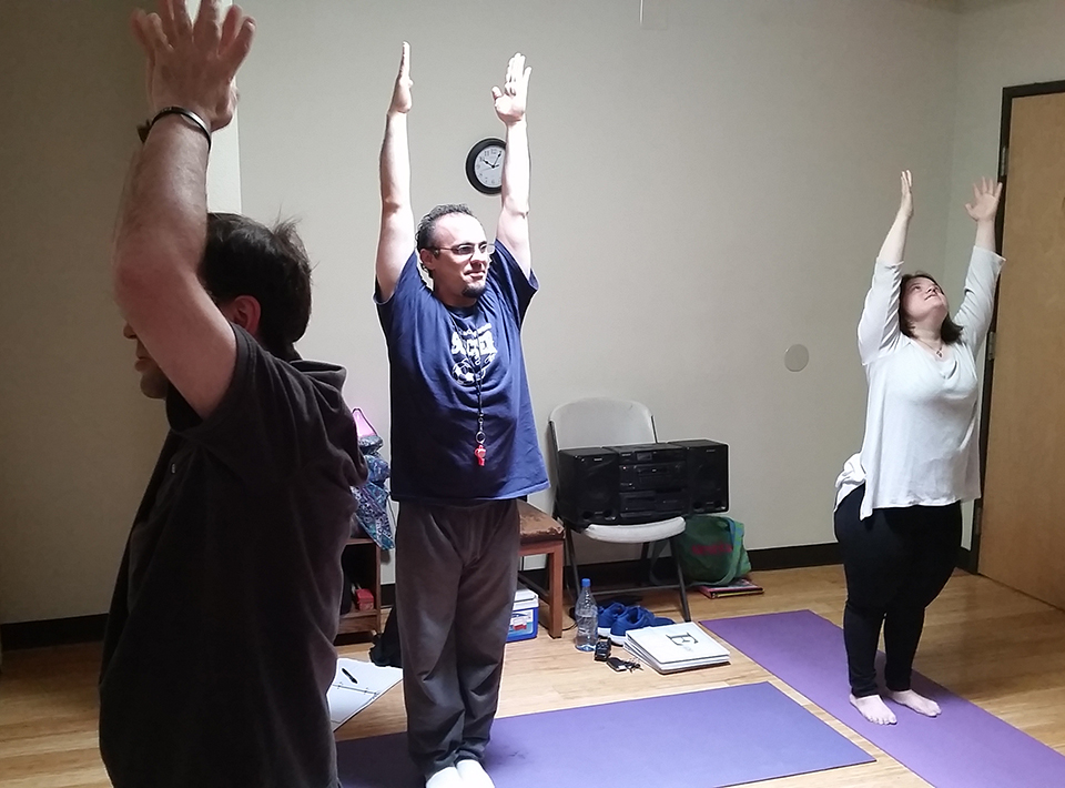 Yoga and movement class where members stretch to build balance and strength.
