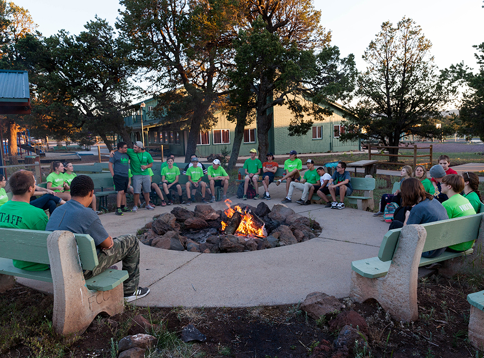 Camp Civitan campers sit around fire ring at the camp.